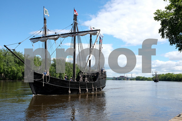 060717 Wesley Bunnell | Staff Replicas of Christopher Columbus' ships the Nina, front, and the Pinta sail up the Connecticut River towards the riverfront in Hartford to dock on Wednesday afternoon. Colt's famous Blue Onion Dome can be seen to the right along with the Charter Oak Bridge in the background.