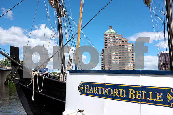 060717 Wesley Bunnell | Staff The Hartford Belle sits at dock as a replica of Christopher Columbus' ship the Nina arrives on the Hartford riverfront on Wednesday afternoon. A large apartment complex in East Hartford can be seen in the background.