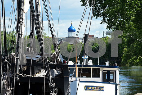 060717 Wesley Bunnell | Staff Colt's Blue Onion Dome can be seen through the rigging of a replica of Christopher Columbus's the Nina as she sits at dock in Hartford on Wednesday afternoon.