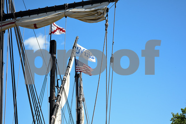 060717 Wesley Bunnell | Staff Flags fly in the rigging of a replica of Christopher Columbus's ship the Nina as she sits at dock on the riverfront in Hartford on Wednesday afternoon.
