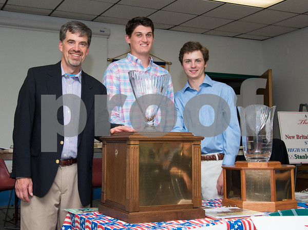 060817 Wesley Bunnell | Staff The New Britain/Berlin Rotary Club held an awards luncheon on Thursday afternoon honoring high school golfers from both boys and girls teams from New Britain, Berlin and the boys team from EC Goodwin. The 54th Annual Stan Pisk Memorial High School Golf Championship was previously held on Tuesday May 30. Berlin boys coach John Line poses with the championship trophy and two of the players.
