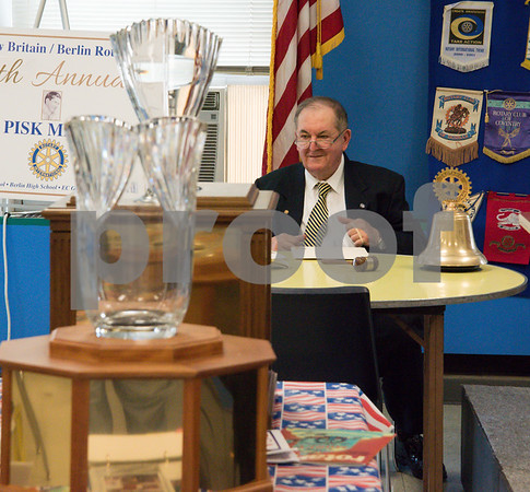 060817 Wesley Bunnell | Staff The New Britain/Berlin Rotary Club held an awards luncheon on Thursday afternoon honoring high school golfers from both boys and girls teams from New Britain, Berlin and the boys team from EC Goodwin. The 54th Annual Stan Pisk Memorial High School Golf Championship was previously held on Tuesday May 30. Ted Pisk, son of the late Stan Pisk, sits at the end of the ceremony with the boys and girls championship trophies on the table.