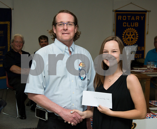 060817 Wesley Bunnell | Staff The New Britain/Berlin Rotary Club held an awards luncheon on Thursday afternoon honoring high school golfers from both boys and girls teams from New Britain, Berlin and the boys team from EC Goodwin. The 54th Annual Stan Pisk Memorial High School Golf Championship was previously held on Tuesday May 30. Berlin High School's Darby Trowbridge poses with Rotary President Kenneth Jones as she receives her scholarship.