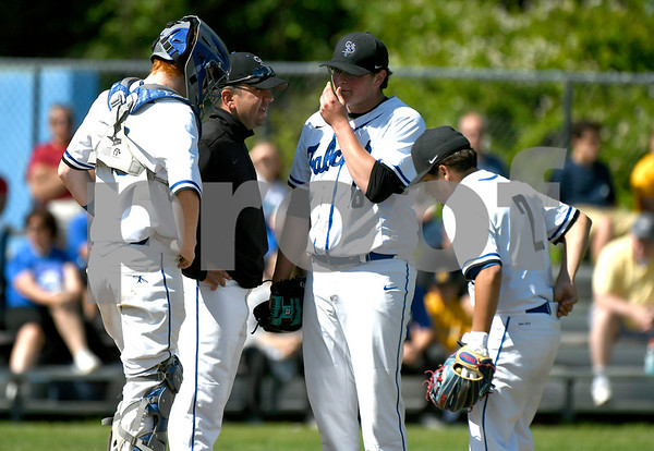 6/3/2017 Mike Orazzi | Staff St. Paul Catholic High School's Vic Rinaldi talks with Christopher Mills (16), pitcher Wes Lahey (18) and Nick Morrell (2) during a 7-6 loss in the Class S Quarterfinal baseball game with Housatonic Regional Saturday in Bristol.