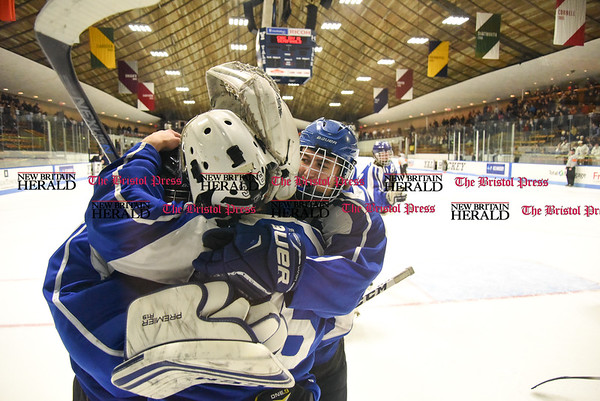031617 Wesley Bunnell | Staff Hall-Southington hockey defeated Middletown-Rocky Hill-Plainville with a 1-0 victory in a CIAC DIII semifinal game played at Ingalls Rink Yale University on March 16, 2017. Teammates mob goalie Zachary Monti (36) after the win.
