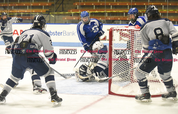 031617 Wesley Bunnell | Staff Hall-Southington hockey defeated Middletown-Rocky Hill-Plainville with a 1-0 victory in a CIAC DIII semifinal game played at Ingalls Rink Yale University on March 16, 2017. WMRP goalie Stephen Vaughan (35) with a deflection.
