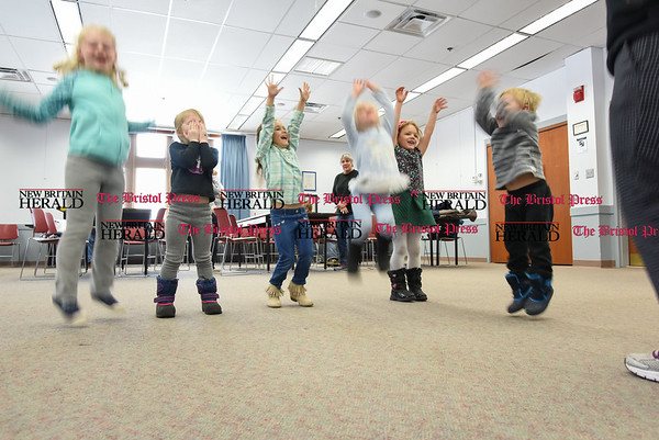 031617 Wesley Bunnell | Staff Thursday's at the Berlin-Peck Library feature Bookworms which is a free program targeting children 3-5 years old. The program helps teach independence and a love of reading. Jumping in the air to the tune of If You're Happy & You Know It are, from left, 7 year old Sydelle Holland, 4 year old Rylin Holland, 4 year old Carolina Foster, 4 year old Catherine Puzio, 4 year old Annabelle Meagher and 3 year old Michael Beyer.