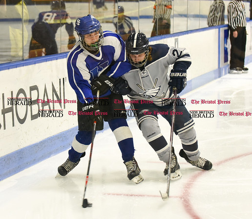031617 Wesley Bunnell | Staff Hall-Southington hockey defeated Middletown-Rocky Hill-Plainville with a 1-0 victory in a CIAC DIII semifinal game played at Ingalls Rink Yale University on March 16, 2017. Graham Kennedy (18) for Hall-Southington and Sean Fuller (27) for WMRP.