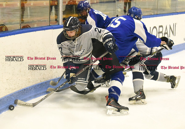 031617 Wesley Bunnell | Staff Hall-Southington hockey defeated Middletown-Rocky Hill-Plainville with a 1-0 victory in a CIAC DIII semifinal game played at Ingalls Rink Yale University on March 16, 2017. Sean Fuller (27) for WMRP fights for the puck.