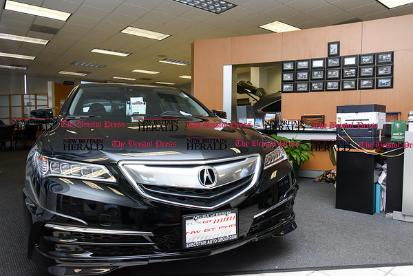 030717 Wesley Bunnell | Staff Automobiles for sale at the interior showroom at Acura of Berlin on March 7.