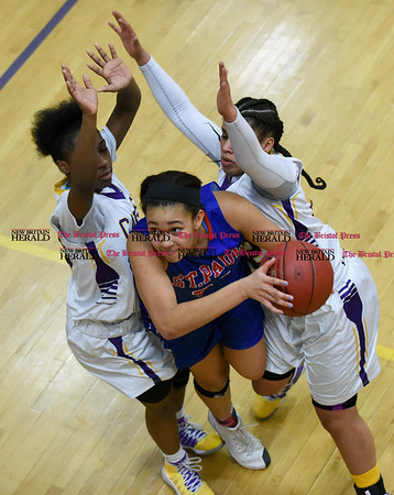 030917 Wesley Bunnell | Staff St. Paul's girls basketball was defeated by Career Magnet in a Class M CIAC playoff game played at Career High School in New Haven on March 9. Center Jade Udoh (24)