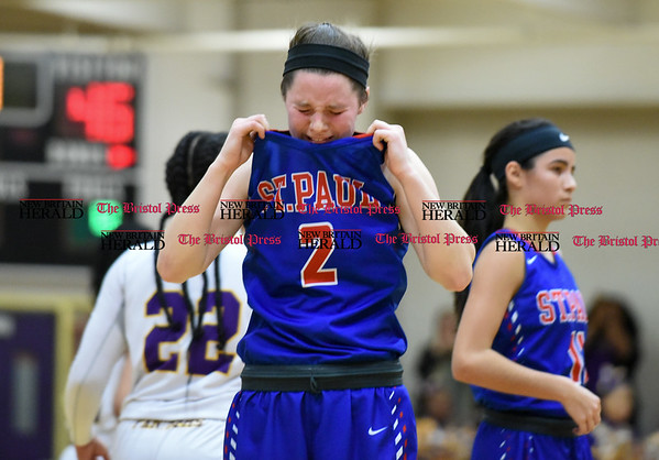030917 Wesley Bunnell | Staff St. Paul's girls basketball was defeated by Career Magnet in a Class M CIAC playoff game played at Career High School in New Haven on March 9. Guard Captain Brigid Johndrow (2) becomes emotional after the tough loss.