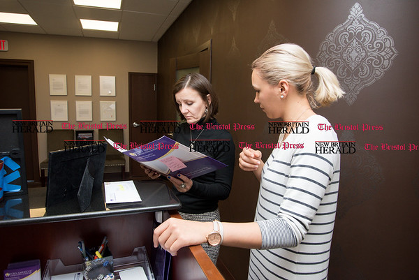 030817 Wesley Bunnell | Staff Human Resources Manager Dorothy Kolodziej , left, speaks with Project Coordinator Yulia Vasilenko of Euro-American Connections & Homecare Care regarding a patients chart on March 8.