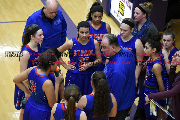 f030917 Wesley Bunnell | Staff St. Paul's girls basketball was defeated by Career Magnet in a Class M CIAC playoff game played at Career High School in New Haven on March 9. Head Coach Joe Mone addresses his team.