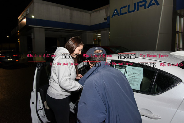 030717 Wesley Bunnell | Staff Salesman Gerald Campana assists customer Brianna Valeriano with a test drive prior to purchasing a car from Acura of Berlin on March 7.