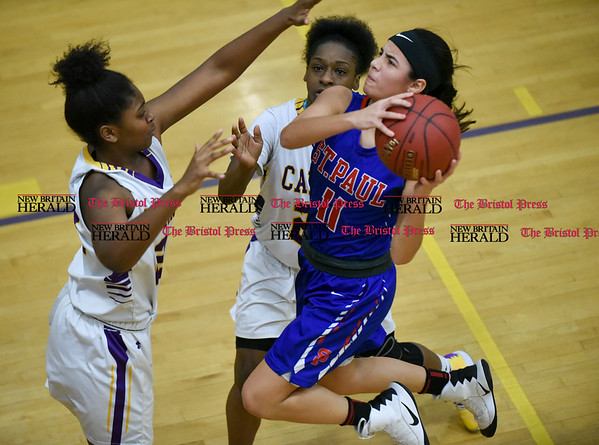 030917 Wesley Bunnell | Staff St. Paul's girls basketball was defeated by Career Magnet in a Class M CIAC playoff game played at Career High School in New Haven on March 9. Guard Janessa Gonzalez (11)