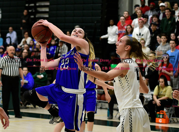3/9/2017 Mike Orazzi | Staff Southington's Hartlee Meler (22) and Enfield's Erica Lovering (4) in the Class LL Quarterfinal in Enfield Thursday night.