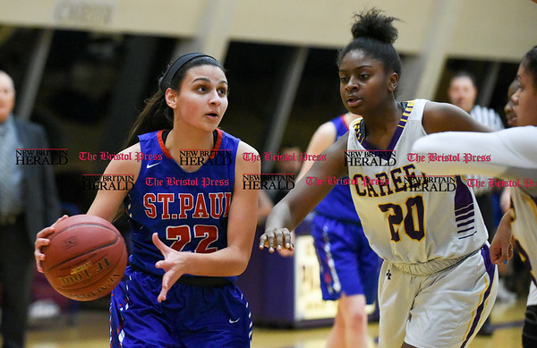 030917 Wesley Bunnell | Staff St. Paul's girls basketball was defeated by Career Magnet in a Class M CIAC playoff game played at Career High School in New Haven on March 9. Forward Amelia Sanchez (22).