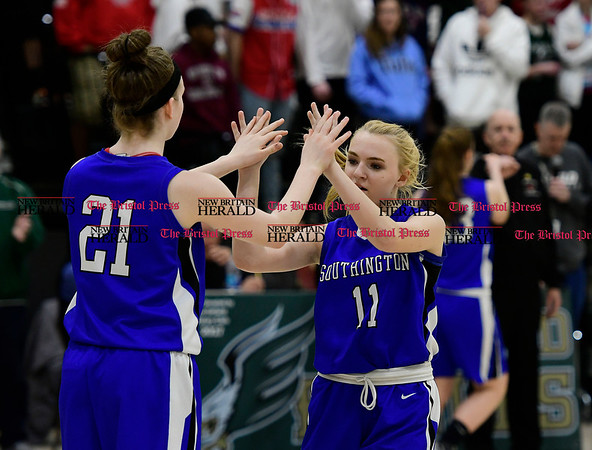 3/9/2017 Mike Orazzi | Staff Southington's Madison Hulten (21) and Kristen Longley (11) in the Class LL Quarterfinal in Enfield Thursday night.