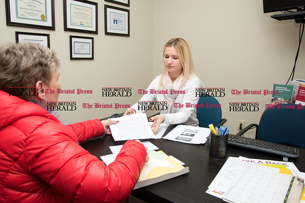 030817 Wesley Bunnell | Staff Euro-American Connections & Homecare's Staffing Coordinator Alyna Marcello, right, interviews new caregiver Grace Stachowicz on March 8.