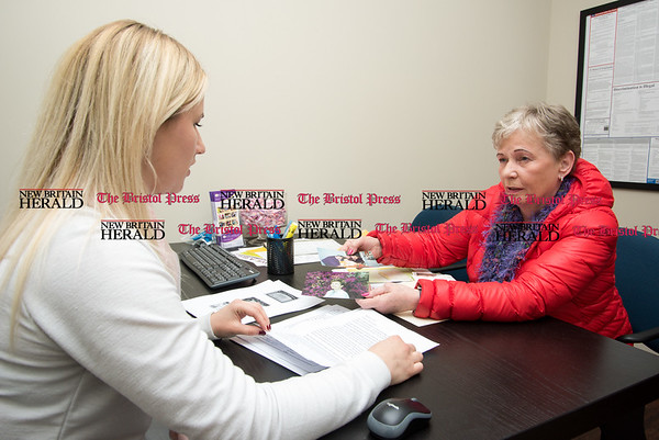 030817 Wesley Bunnell | Staff Euro-American Connections & Homecare's Staffing Coordinator Alyna Marcello, left, interviews new caregiver Grace Stachowicz as Grace shows her references from previous employment.