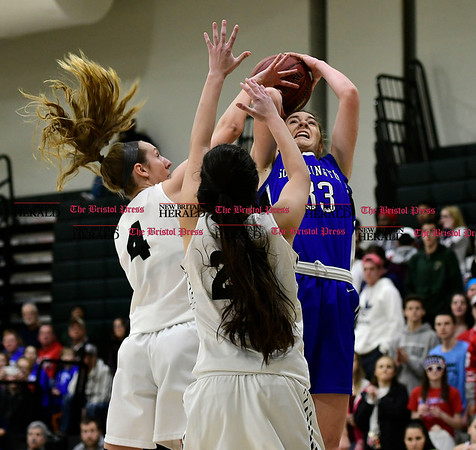 3/9/2017 Mike Orazzi | Staff Southington's Janette Wodolowski (33) and Enfield's Erica Lovering (4) in the Class LL Quarterfinal in Enfield Thursday night.