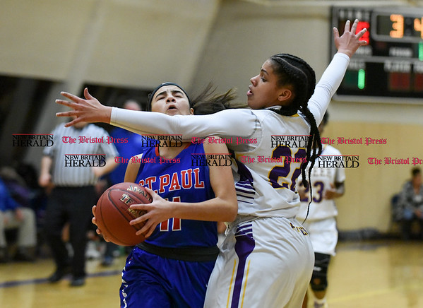 030917 Wesley Bunnell | Staff St. Paul's girls basketball was defeated by Career Magnet in a Class M CIAC playoff game played at Career High School in New Haven on March 9. Guard Janessa Gonzalez (11).