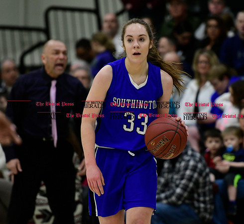 3/9/2017 Mike Orazzi | Staff Southington's Janette Wodolowski (33) in the Class LL Quarterfinal in Enfield Thursday night.