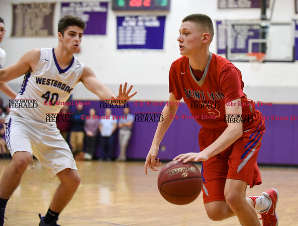 031317 Wesley Bunnell | Staff St. Paul boys basketball was defeated in a Class S CIAC playoff game against Westbrook on Monday March 13. Matthew Garry (3)