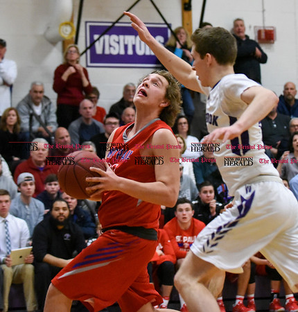 031317 Wesley Bunnell | Staff St. Paul boys basketball was defeated in a Class S CIAC playoff game against Westbrook on Monday March 13. Darek Wiecki (31)