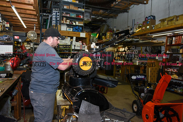 031317 Wesley Bunnell | Staff Snow shovels and snow blowers were sold out on Monday March 13 at City Hardware True Value in Bristol in preparation for the upcoming storm. Manager Brenton Eckstrom makes repairs to a customers snow blower.