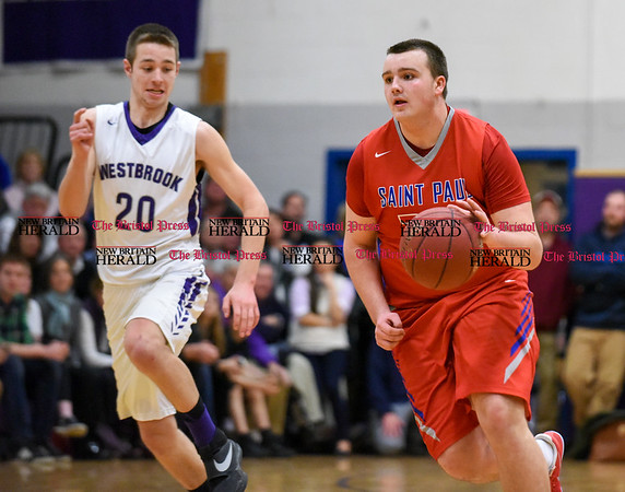 031317 Wesley Bunnell | Staff St. Paul boys basketball was defeated in a Class S CIAC playoff game against Westbrook on Monday March 13. Brian Considine (35)