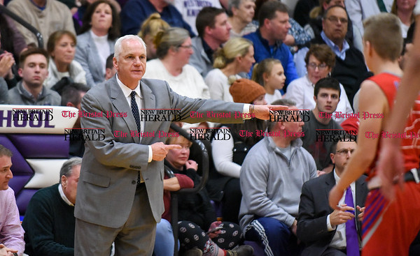 031317 Wesley Bunnell | Staff St. Paul boys basketball was defeated in a Class S CIAC playoff game against Westbrook on Monday March 13. Head Coach Steve Phelps motions to one of his players.