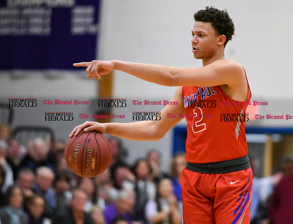 031317 Wesley Bunnell | Staff St. Paul boys basketball was defeated in a Class S CIAC playoff game against Westbrook on Monday March 13. Captain Austin Jones (2)