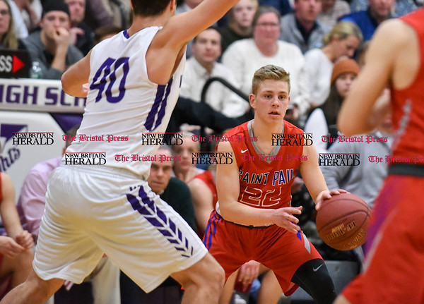 031317 Wesley Bunnell | Staff St. Paul boys basketball was defeated in a Class S CIAC playoff game against Westbrook on Monday March 13. Bo Arndt (22)