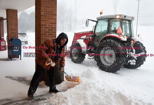 3/14/2017 Mike Orazzi | Staff Rob Desmarais while clearing snow with a shovel and his 110 horse power Massey Ferguson tractor at the Rite Aid Plaza in Plymouth during Tuesday's snow storm.