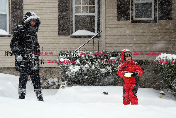 3/14/2017 Mike Orazzi | Staff Michelle Fleming and her son Tyler,2, while outside during Tuesday's snow storm on Spruce Street in Bristol.