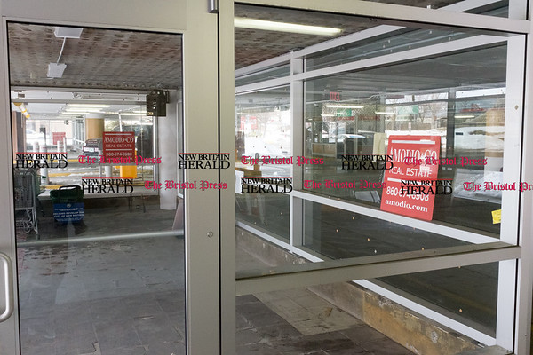 032117 Wesley Bunnell   Staff 31 Bank St New Britain storefront of the Szczesny Parking Garage. Ticket Defenders which will be a satellite office of the Howard Law Firm will occupy the space.