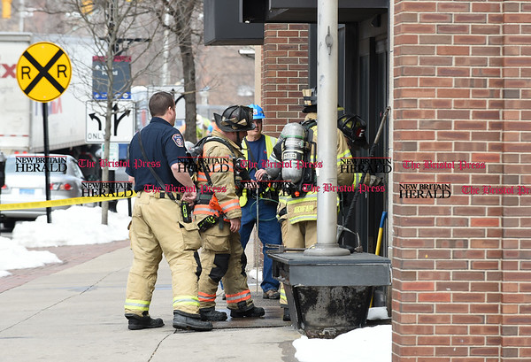032117 Wesley Bunnell | Staff The New Britain Fire Department investigated a possible gas leak at 267 Main St on March 21, 2017. Firefighters needed to force entry into the building.