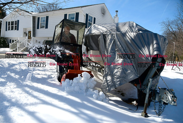 3/21/2017 Mike Orazzi | Staff Ed Jalbert clears snow from around his boat off Matthews Street in Terryville while cleaning up from last week's snow storm.
