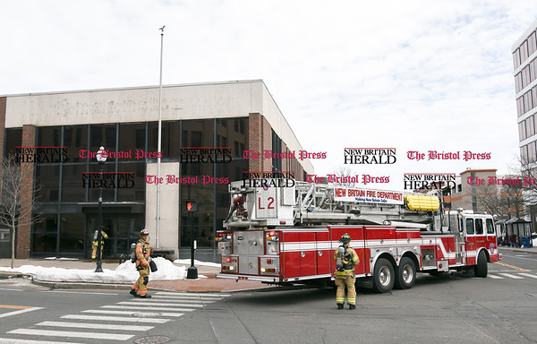 032117 Wesley Bunnell   Staff The New Britain Fire Department investigated a possible gas leak at 267 Main St on March 21, 2017. Ladder 2 in the intersection of Main & Bank St.