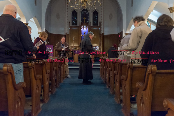 031017 Wesley Bunnell | Staff Fr. Robert Schlageter leads parishioners at Sacred Heart Church in East Berlin in Stations of the Cross on March 10, 2017. St. Paul's and Sacred Heart in East Berlin have merged leading to the eventual closing of Sacred Heart.