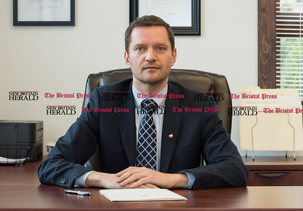 032417 Wesley Bunnell | Staff Honorary Consul Darek Barcikowski of the Honorary Consulate of the Republic of Poland in Connecticut in his office at 55 Broad St on March 24, 2017.