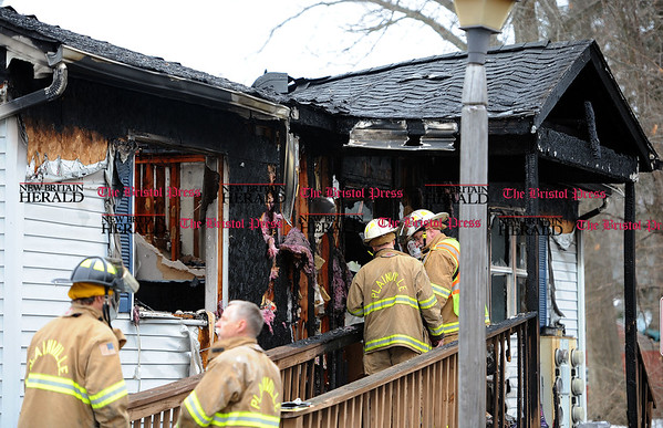 3/24/2017 Mike Orazzi | Staff Plainville firefighters on scene of house fire on Milford Street Extension Friday morning.