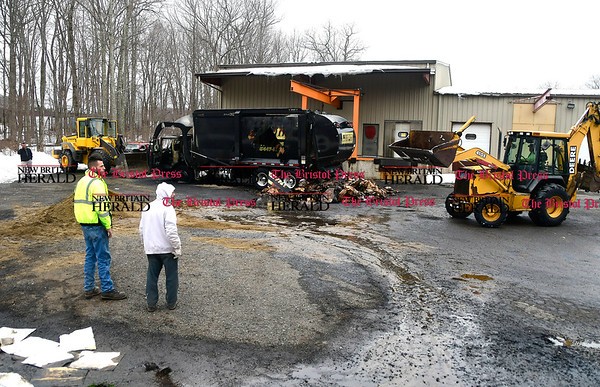 3/24/2017 Mike Orazzi | Staff A burned up CWPM waste removal truck that caught fire and was destroyed off Napco Drive in Plymouth Friday morning. Terryville firefighters unloaded the truck with a backhoe and cut a hole in the side in order to extinguish the blaze.