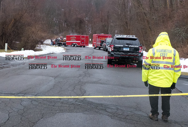 032717 Wesley Bunnell | Staff Fire and police personnel from several towns gathered on a trail just off of Trumbull Lane in Farmington searching for a missing hiker on March 27, 2017. Farmington & Plainville rescue vehicles prepare to leave the area around noon.