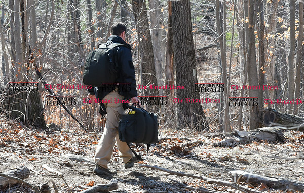 033017 Wesley Bunnell | Staff Plainville detectives enter the woods off of Loon Lake Road to aid in the search for missing hiker Arthur Williams. Williams was last seen on Saturday.
