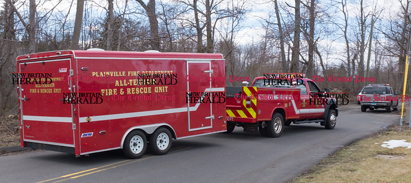 033017 Wesley Bunnell | Staff Plainville Police Department's All Terrain Fire & Rescue Unit arrives at the scene on Loon Lake Road to aid in the search for missing hiker Arthur Williams who was been missing since Saturday.