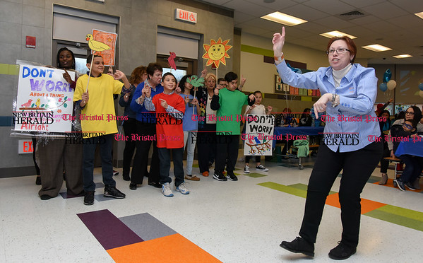 033017 Wesley Bunnell | Staff Gaffney Elementary School held their 7th annual Family Autism Dinner on Wednesday evening. The dinner brings together families, teachers, staff members and volunteers together to socialize with loved ones with autism. Teacher Cynthia Kosc-St. Onge leads students in a rendition of Bob Marley's Everything's Gonna Be Alright. Singing is teacher Phyllis Wahtts, left, Roberto Alvarez, Antonio Mercado and Alex Gonzalez.