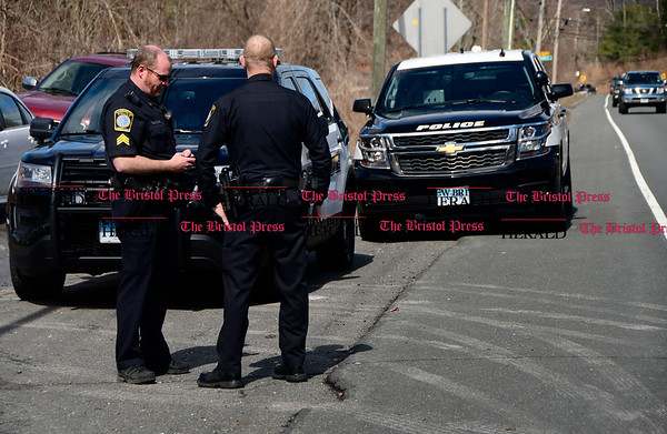 3/29/2017 Mike Orazzi | Staff Farmington Police blocking the entrance to the Metacomet trail off Route 6 as Connecticut State Police search the area for a missing hiker with dogs and the use of drone Wednesday morning.